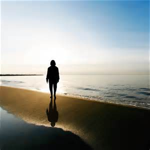 silhouette of woman on beach